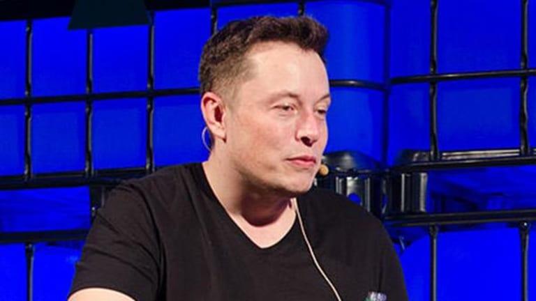 Tesla Tumbles as Goldman Sachs Downgrades Stock on Model 3 Concerns