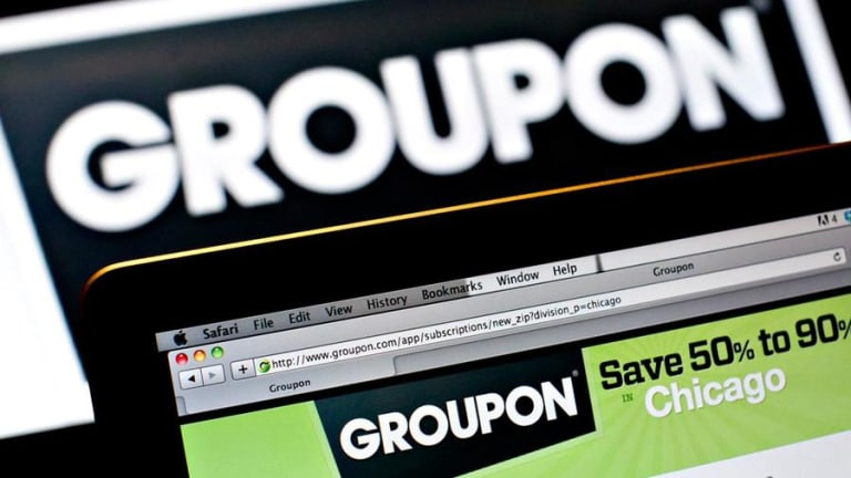 Groupon Shares Slump as Goldman Sachs Cuts Rating to Sell on Provider of Deal Coupons
