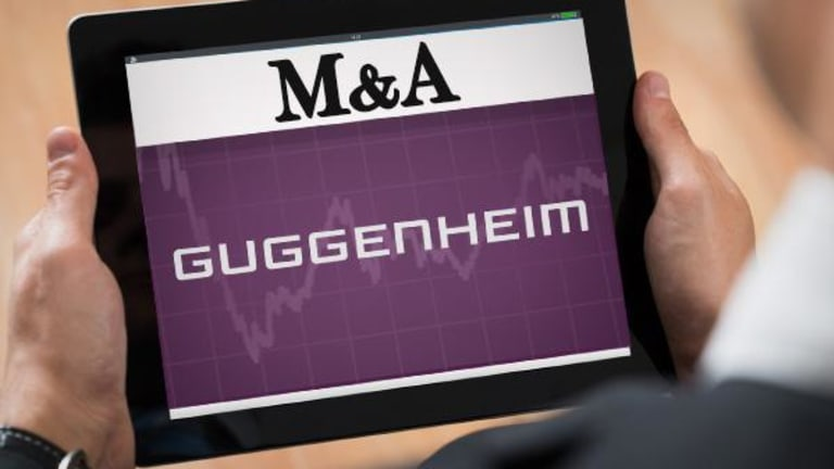 Invesco Negotiating With Guggenheim to Purchase Piece of Management Business