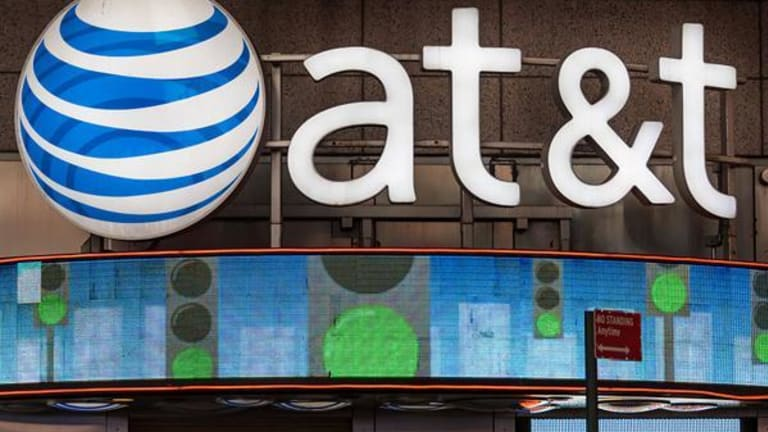AT&T Slides After Cowen Cuts Rating and Slashes Outlook