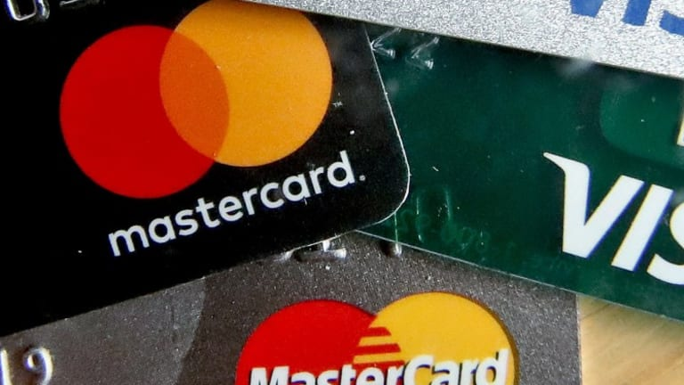Mastercard and Visa Shares Cut to Hold as Jefferies Cites Fallout From Virus