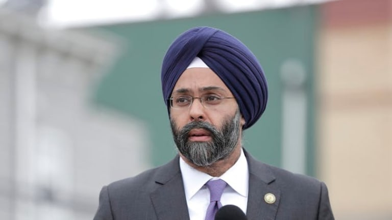 Who are the Sikhs and what are their beliefs?