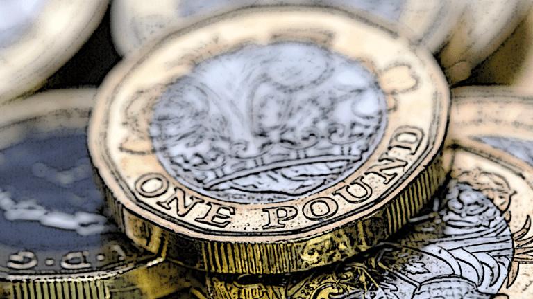 Pound Rallies as U.K. Economy Picks Up in Third Quarter