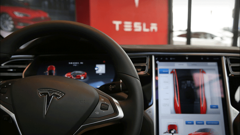 Tesla Jumps After Filing to Raise About $2B: Musk Also to Buy Stock