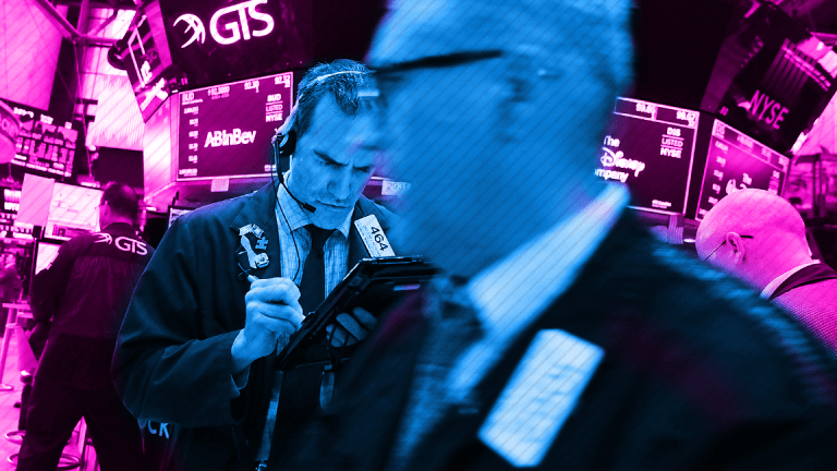 Dow Finishes Slightly Lower as Nasdaq Jumps to Another Record Close