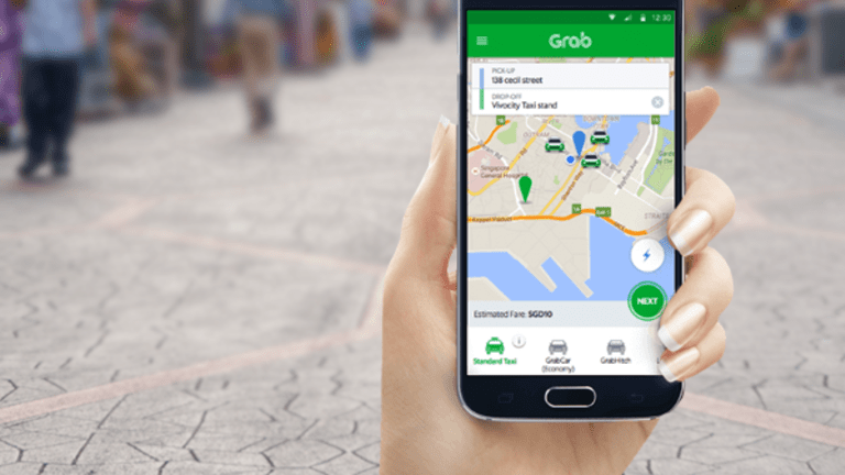 Toyota Takes Stake In Grab as Uber's Asia Challenges Intensify