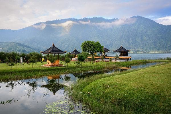 Bali, IndonesiaTravelers enjoy Bali for its white sand beaches, snorkeling among coral reefs and shipwrecks, the sacred monkey forest and the Tanah Lot Temple. Shown, Ulun Danu Park.Photo: Shutterstock