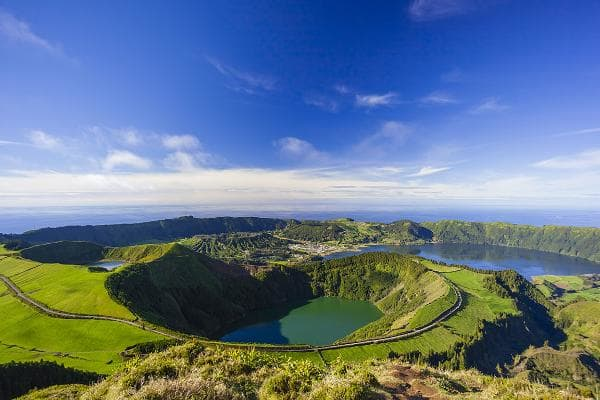 The Azores, PortugalThis archipelago of volcanic islands sits nearly 900 miles off the coast of of Portugal and features vineyards, fishing villages, lake-filled calderas, and landscapes covered in blue hydrangeas. The best times to visit are April to September. Pictured here is the Sete Cidades volcano and village on the island of Sao Miguel. Photo: Shutterstock