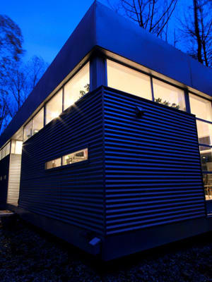 """Prefab is a catchall term that refers to homes that are at least partly manufactured in a factory, then shipped and assembled on-site. These days, prefabs are typically two types – modulars that arrive in just a few sections complete with attached walls, flooring and finishes; or panelized """"kits,"""" which are delivered mostly in flat smaller pieces and put together on-site. There are upsides and downsides to both methods. Generally, modulars tend to be more cost-effective, but panelized kits are easier to ship. Prefabrication techniques reduce waste, making it a more eco-friendly homebuilding method, and factory precision keeps modern clean edges and angles all in line. Of course, there are cost benefits: Many are entirely or partly pre-designed, so you pay less for architect and engineering fees. Since much construction is done off-site, you'll be less likely to run over budget with your contractor, and can count on a shorter and more predictable build schedule with fewer rain delays or misaligned details. If you're considering buying a prefab home, you'll need some land to build on and will have to factor in the specific challenges of your site when deciding on the type of prefab that suits your location. Some prefabs travel on long, wide-load trucks, and the truck widths and lengths will limit some road access. There are other site considerations – including permits, local codes and accessibility to utilities – but most reputable prefab companies will walk you through everything you need to get a well-built prefab home onto your property. Read on for a few to check out. Photo Credit: ZM73"""