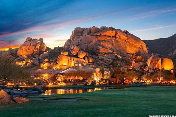 "The spectacular 12-million-year-old boulder formations that dot the landscape at Boulders Resort & Spa create a dramatic backdrop for performing your yoga poses. But don't let the rugged desert setting fool you: the resort provides true luxury with its newly renovated guest casitas and villas, two 18-hole championship golf courses, four swimming pools and 33,000-square-foot spa.Located about 30 miles north of Phoenix in Carefree, Ariz., Boulders offers an array of complimentary yoga classes for guests, which are taught both at the spa's yoga studio as well as in various outdoor settings. For instance, you can practice your ""downward-facing dog"" and ""tree"" poses in the resort's 5,600-square-foot organic garden, which features naturally flowing water, a reflection pond, raised planter boxes, citrus trees and an elevated teak platform for moonlight yoga classes. Or for an extra fee, you can take ""Paddleboard Yoga,"" an hour-long yoga class taught at the spa's swimming pool for all levels. Participants stand on paddleboards while practicing yoga moves, which helps strengthen muscles while bringing peace of mind through the serenity of the water.If you'd like to book a stay, consider staying in a luxurious one-, two- or three-bedroom villa, which starts at $600 per night."