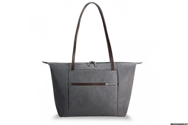 Briggs & Riley's Horizontal Tote from the new Kinzie Street Collection is stylish enough to provide a sleek, compact look while at the same time providing ample room to hold both a 15-inch laptop and a sizeable pair of your favorite shoes inside. Designed from embossed textured herringbone fabric, this bag maintains its dignified style, but is tough enough to repel moisture. The tote's interior material is a light color, which makes it easy to find those important items. The pocket slip is well padded to protect your technology, while two deep interior pockets are ideal for storing accessories. Offered in grey or navy, Briggs & Riley is the only luggage company to offer a lifetime repair guarantee on merchandise.Buy the Briggs & Riley Horizontal Tote now