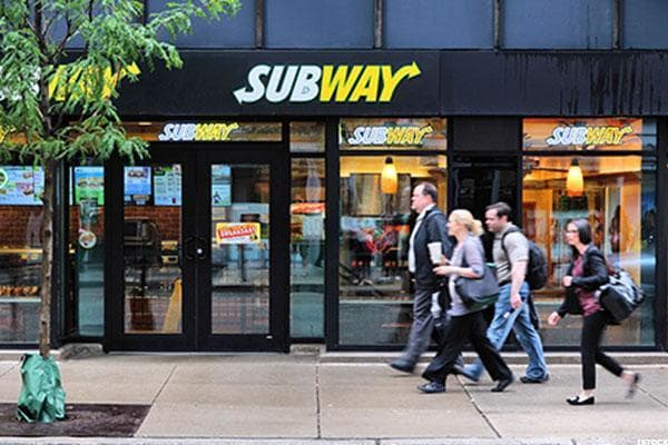 """Subway Sandwiches is the world's largest fast food company, boasting more than 44,000 locations in 111 countries including Afghanistan, Kosovo and Pakistan. Yet, seemingly oddly for a fast food chain, it's owned by a group called Doctor's Associates, Inc.The reason is that Subway was founded by a Ph.D. named Dr. Peter Buck and a 17-year-old who hoped to go to medical school named Fred Deluca.Subway opened its first shop as Pete's Subway in Bridgeport, Conn. using $1,000 in seed money from Buck. Oddly enough for a local sandwich joint opened by an academic and a teenager, the pair """"set a goal of having 32 stores opened in 10 years"""" once Deluca """"learned the basics of running a business,"""" per the company website.While that's a little like opening a lemonade stand with the goal of purchasing Snapple by the next quarter, who are we to argue with success? Whatever Deluca and Buck did, it worked, and that $1,000 made them both billionaires."""