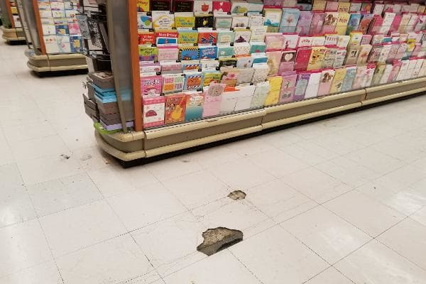 The first thing I noticed when I walked through the door were the floors. All over, the tiles were cracked and indented. Parts of tiles were missing, too, and my shoe got caught on this one.