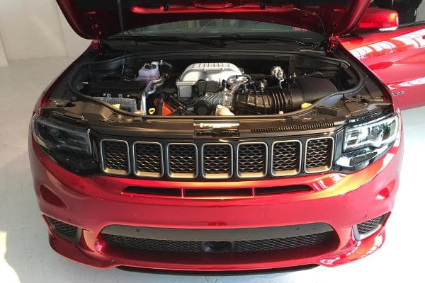 The Hellcat engine peeks out from under the TrackHawk's menacing front end.
