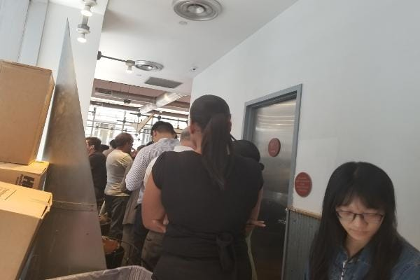 I arrived to Chipotle at 1:20 p.m. on Wednesday, and the restaurant was still busy. I had to weave my way through the restaurant to make it to the back of the line. By the time I found the end, I couldn't even see the front.