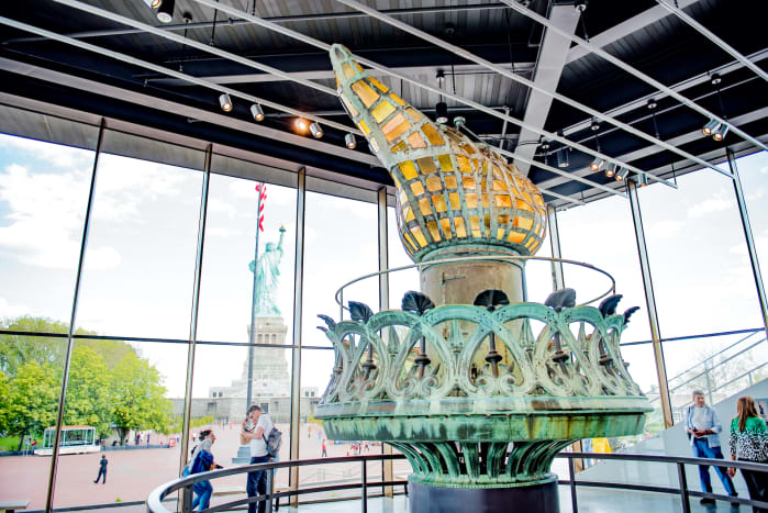 The $70 million Statue of Liberty Museum opened in May 2019, and features three galleries with cultural artifacts and multimedia displays telling the story of the Statue of Liberty. It includes the original torch, shown here, which was replaced in 1984.