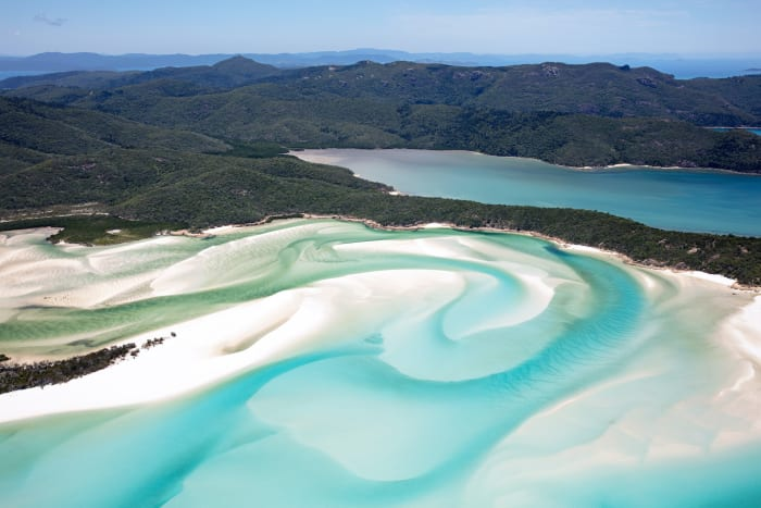 This slice of paradise is located in the heart of the Great Barrier Reef, and with its white sand and clear azure waters is one of the world's most unspoiled and beautiful beaches. The beach is protected as part of a national park. The island is accessible by boat, seaplane or helicopter.
