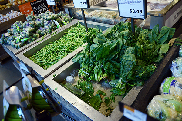Would you pay $3.49 a pound for spinach swimming is this bin of melted ice and discarded leaves?
