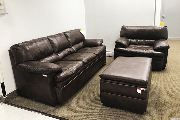This is not a shot of your friend's dingy basement. This is a display in a Sears store near a main store entrance. Want it? You can have the couch for $319.97.