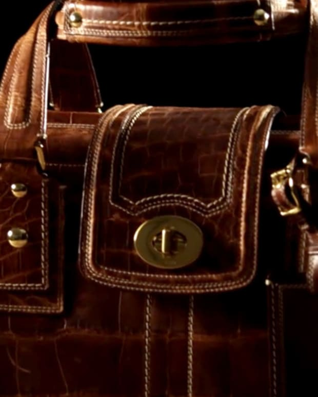 Coach's Earnings Bag, Disney Numbers and Jim Cramer Packs Up UPS