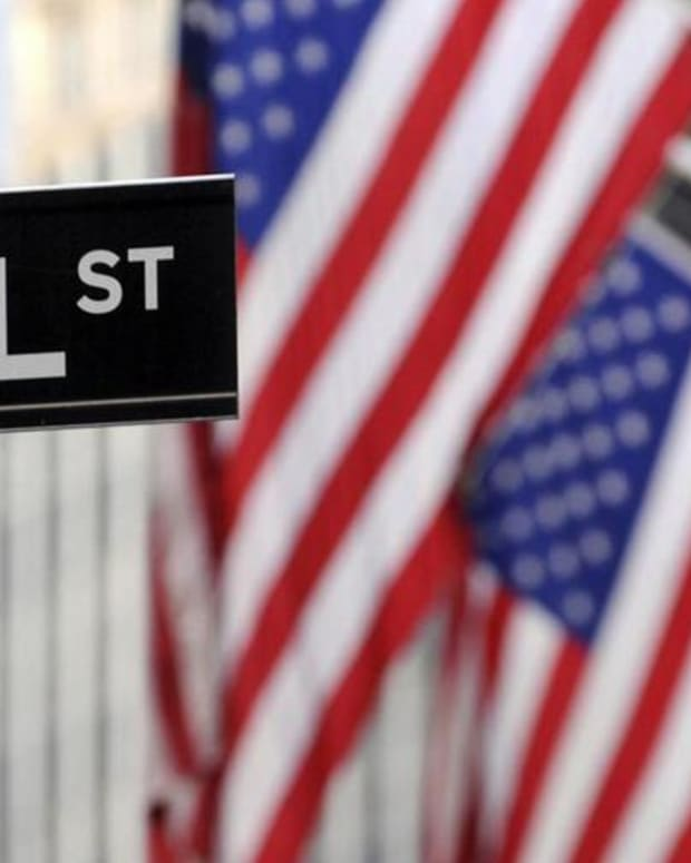 Closing Bell: Banks Lead Wall Street; Fed Signals June Hike