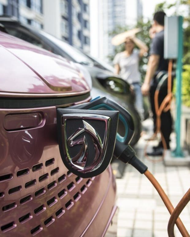 A Baojun E100 electric vehicle plugged in to a charging station outside a SAIC-GM-Wuling Automobile Customer Experience Center in Liuzhou city of Guangxi province on May 23, 2018. Photo: Bloomberg