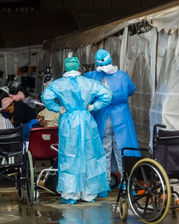 Health care workers and patients in the temporary outside area Steve Biko Academic Hospital created to screen and treat suspected Covid-19 cases in Pretoria. Alet Pretorius/Gallo Images via Getty Images
