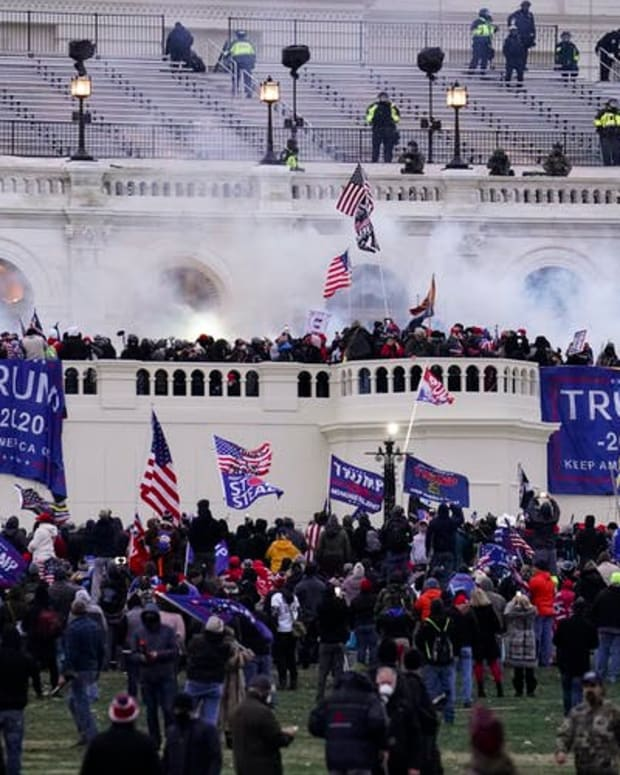 Rioters storm the U.S. Capitol on Jan. 6, 2021, seeking to intimidate politicians into overturning the presidential election.