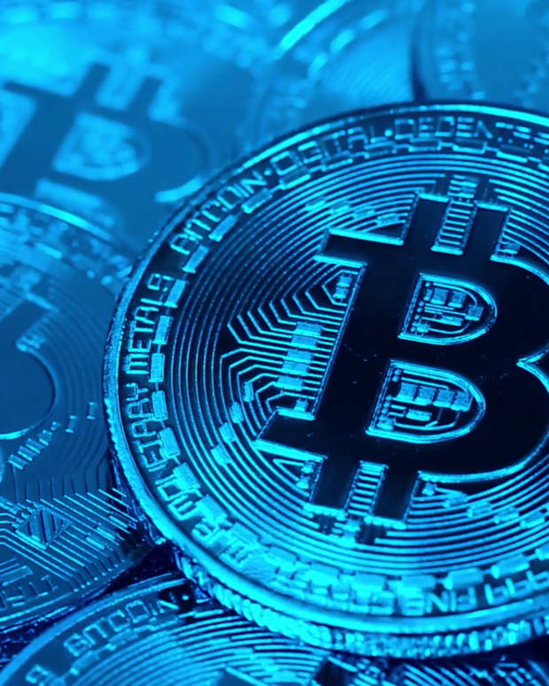 videoblocks-cryptocurrency-bitcoin-btc-bit-coins-rotates-in-blue-light-blockchain-technology-bitcoin-mining-concept-macro-shot-of-bitcoins_s_gjw4zmyf_1080__D
