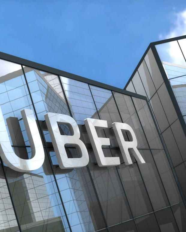 videoblocks-editorial-uber-logo-on-glass-building_bexq-7i-7__D