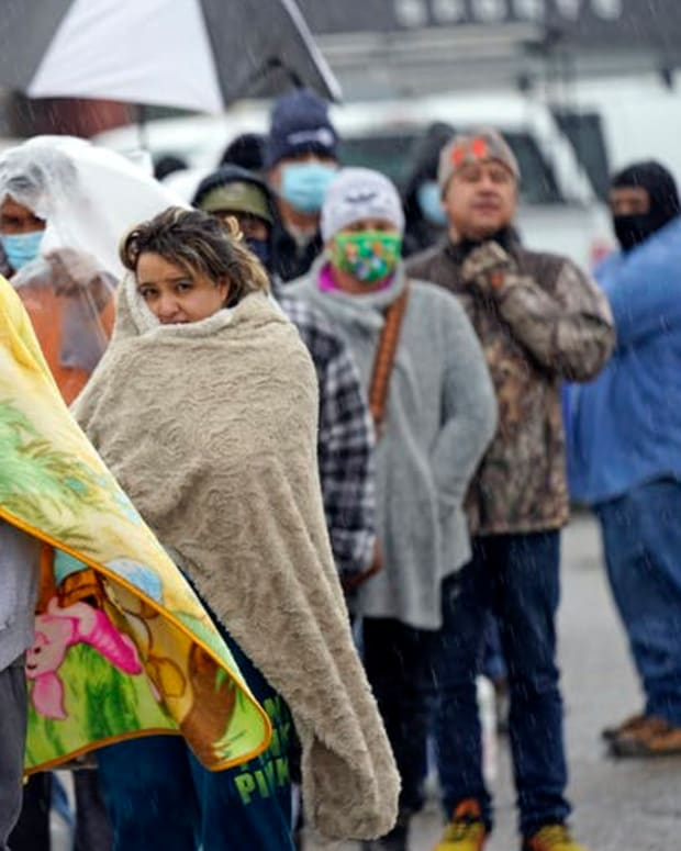 Waiting in line in freezing rain to fill propane tanks in Houston, Texas, Feb. 17, 2021.