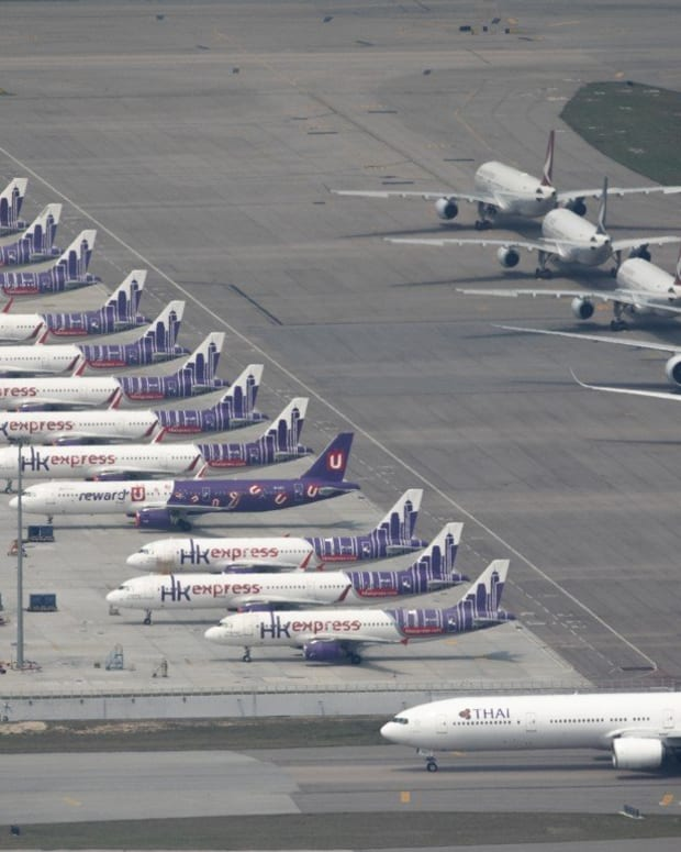 Grounded planes at Hong Kong International Airport earlier this month. One analyst said it was likely 53 per cent of the world's commercial jet fleet would be idle. Photo: Robert Ng