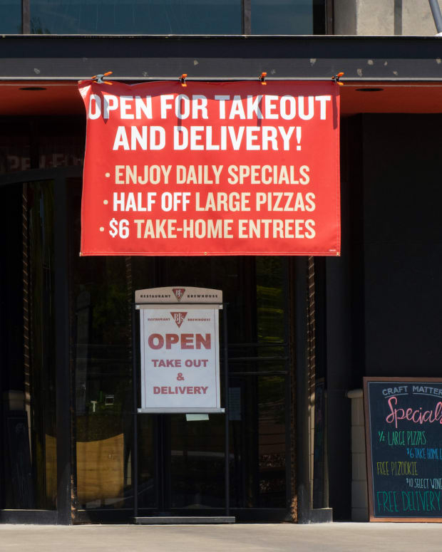 Cary, N.C. USA-- April 4, 2020: A small pizza parlor advertises its takeout and delivery options amid the COVID-19 epidemic.