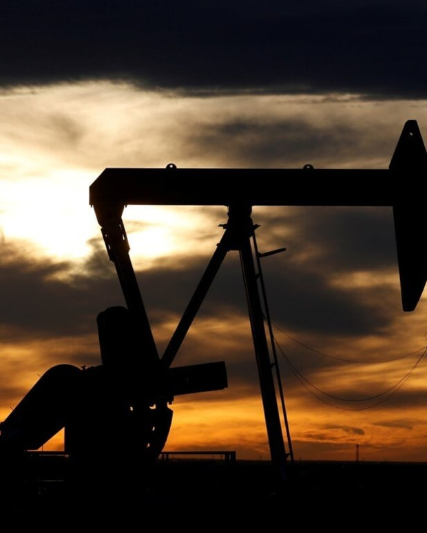 The sun sets behind a crude oil pump in Loving County, Texas. Crude prices have been battered in recent weeks. Photo: Reuters