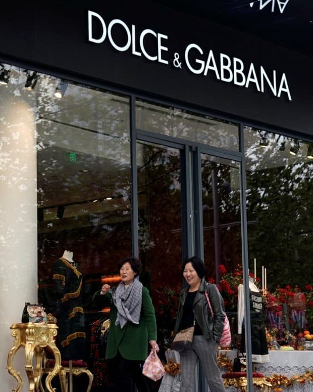 People walk past a Dolce & Gabbana store in Shanghai. Photo: Reuters