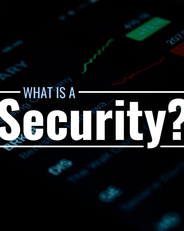 """Dark photo of digital stock portfolio on a screen with text overlay that reads """"What Is a Security?"""""""