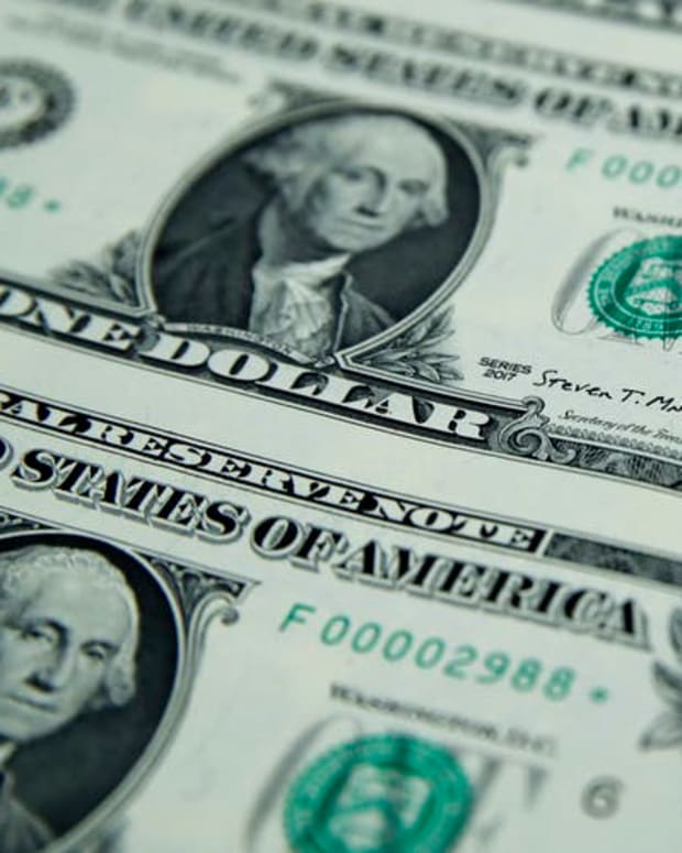 Would a default mean an end to the dollar's position as the go-to trading currency? AP Photo/Jacquelyn Martin