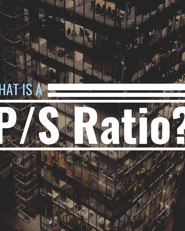 """Darkened photo of high-rise office building with text overlay that reads """"What Is a P/S Ratio?"""""""