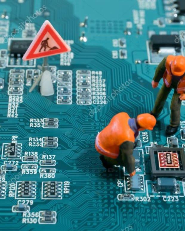 depositphotos_7906156-stock-photo-miniature-engineers-fixing-error-on