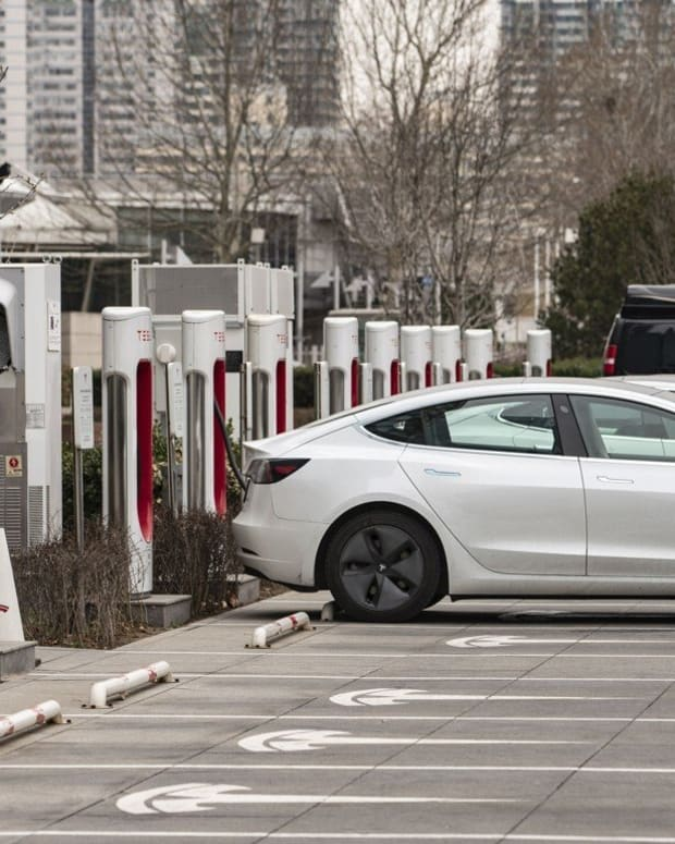 Tesla electric vehicles are parked next to charging stations outside one of the company's showrooms in Beijing. Photo: Bloomberg