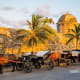 """8. ColombiaFriendly attitude towards expats: 87%Ease of making local friends: 62%Expats likely to stay forever: 33%Out of the 10 most welcoming countries, expats in Colombia are the most likely to be mainly friends with locals (34%). In fact, more than four in five expats describe the Colombians as welcoming and find it easy to settle down in the country.One American finds the Colombians """"open, warm, and friendly,"""" and an expat from the Netherlands adds that they """"are always willing to help.""""Above, horse drawn carriages in Cartagena.Photo: Shutterstock"""