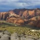 Spectacular red rock bluffs overlook the town in southwestern Utah. It has a mild climate in winter, and terrific recreational opportunities. It is surrounded by national parks, and about 120 miles from Las Vegas. Above, Snow Canyon in St. George, Utah.
