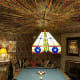 According to various reports, Elvis bought the pool table in 1960, but it wasn't until he had the basement rooms remodeled in the early '70s that he had thewalls and ceiling covered with more than 350 yards of cotton fabric.