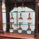 "The square-shaped Maker's Mark bottle is sealed with wax. T. William Samuels' wife, Marjorie ""Margie"" Samuels, reportedly gave the whiskey its name, drew its label, and thought of the wax-dipping process. Photo: TheStreet"