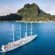 Bora BoraTake a cruise in the blue sea of Bora Bora with a view of Mount Otemanu, above. Visitors enjoythis South Pacific island for the beauty, romance, snorkeling, off-roading and submarine tours.Photo: Shutterstock