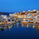 Crete, GreeceThe island of Crete is rich with archaeological and mythological history that's reflected in its ancient ruins and cultural attractions. The least expensive month to go is August, when it is also hottest. Shown, Agios Nikolaos and Voulismeni lake on Crete.Photo: Shutterstock