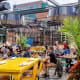 Visitors enjoy outdoor dining in the district.Photo: Gilberto Mesquita / Shutterstock