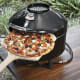 Outdoor Pizza Oven $297 by PizzacraftIt's a lightweight, portable pizza oven that's safe on any surface and hooks up to a propane tank.Photo: Pizzacraft