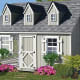 """Little Cottage Cape Cod Cozy Cottage Kennel Dog HouseStarting at $4,024.84 at HayneedleSpare no expense with this""""true-to-life"""" Cape Cod cottage design. It has an 8 x 10-foot floor plan, pine wood frame, Duratemp siding, steel fencing, and an outdoor kennel area with decking.Photo: Hayneedle"""