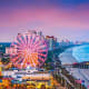 """Best Beach Destinations For Kids:Myrtle Beach, S.C.Surfside Beach, in the Myrtle Beach area, is locally known as """"Family Beach."""" It has plenty of sand for your kids to build sandcastles, as well as water sports, kite flying and other family-friendly activities. There's also the Wonder Works upside down science laboratory and Broadway at the Beach amusement park.Photo: Shutterstock"""